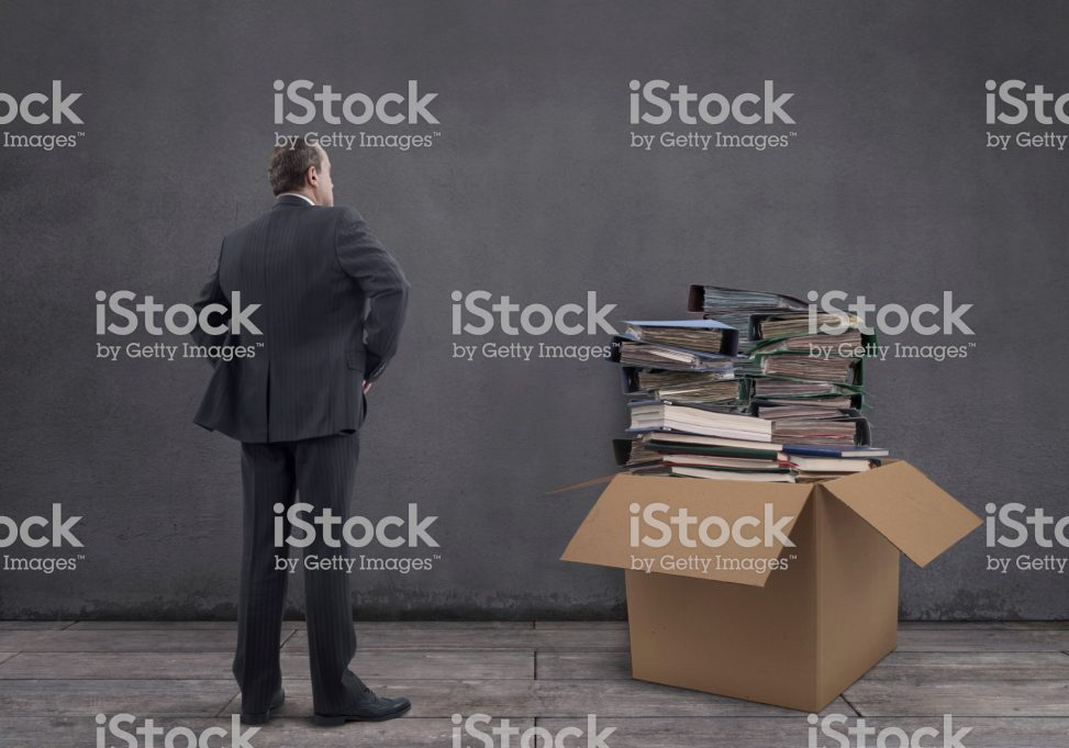 Businessman with Stack of File Folders in the Cardboard Box – mgkaya